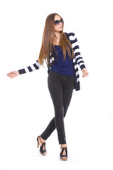 Pretty young woman in stripy shirt and jeans posing