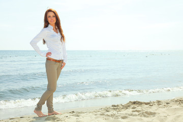 The young happy woman on a beach