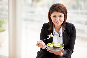 Businesswoman eating a salad