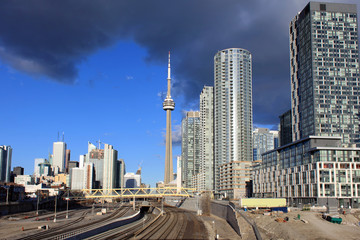 View of downtown Toronto and CN Tower with railway tracks