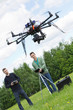 Engineers Flying UAV Drone in Park