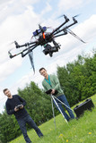 Engineers Flying UAV Drone in Park poster