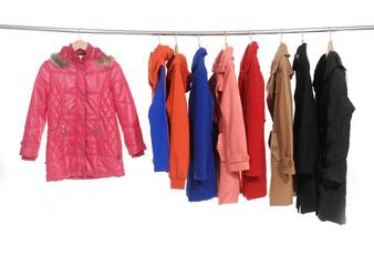 Set of colorful jacket, coat hanging on hanger