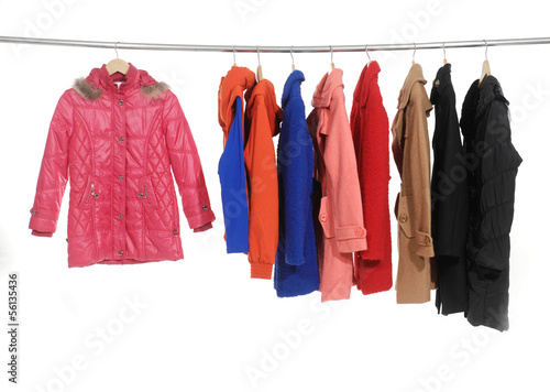 Set of colorful jacket, coat hanging on hanger - 56135436