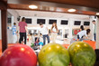 People Bowling With Balls in Foreground