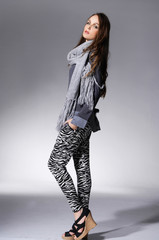 Full length fashion young girl in scarf posing