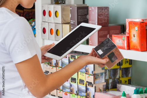 Woman Scanning Barcode Through Digital Tablet