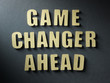The word Game Changer Ahead on paper background