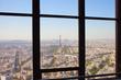 Paris behind window.