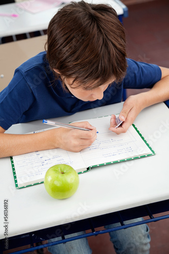 Schoolboy Copying From Cheat Sheet During Examination