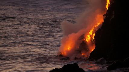 Molten Lava Pouring Over Lava Cliffs Into Ocean