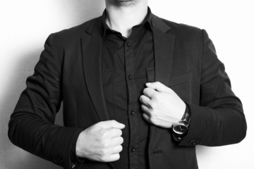 man in a business suit and black shirt.fashion.monochrome