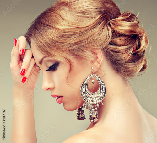 Model with red nails and a cute hairstyle