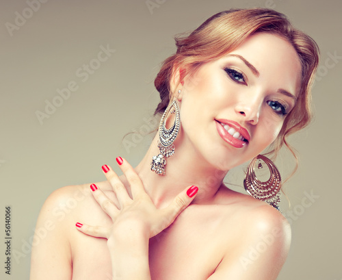Model with red nails and silver earrings