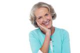 Shy and polite senior smiling woman