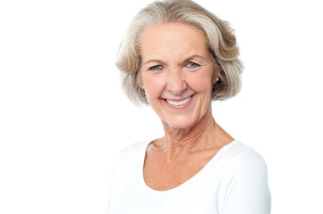 Happy smiling aged lady facing camera