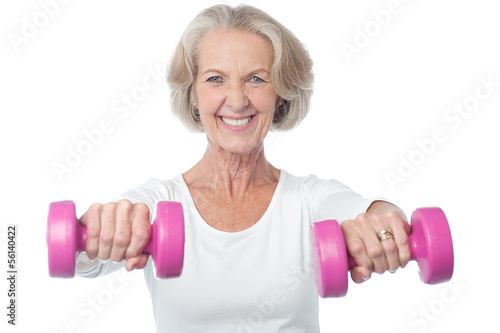 Happy aged woman exercising
