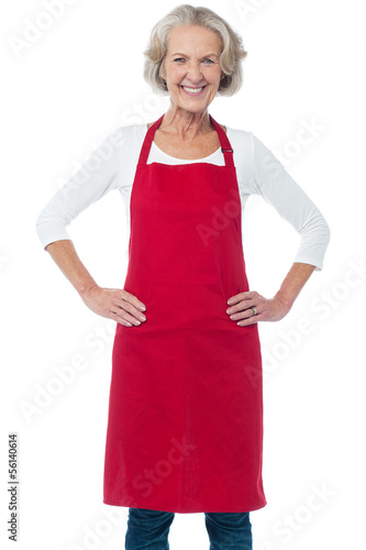 Cheerful aged confident female chef