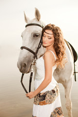 Young woman on a horse. Horseback rider, woman riding horse on b