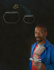 African man industrial worker with jumping fish bowls blackboard