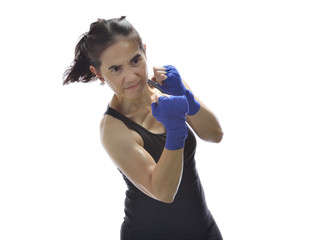 Woman exercising by boxing.