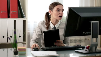 Businesswoman working with tablet computer in the office