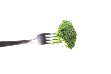 Broccoli floret on a fork.
