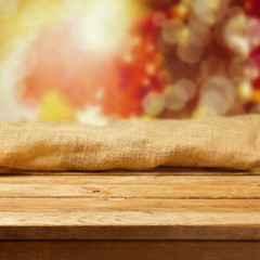 Autumn background with empty wooden deck table