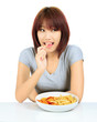 Isolated young asian woman with a plate of potato chips