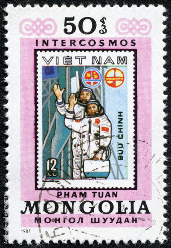stamp printed by Mongolia, shows Vietnam Cosmonauts