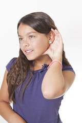 girl listening with hand to ear