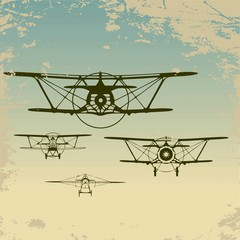 Old planes flying in the clouds,  retro aviation background.
