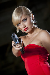 Retro woman pointing gun