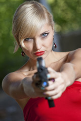 Woman pointing gun