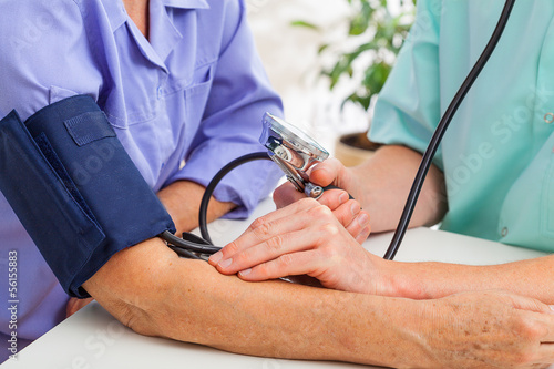 Doctor taking pulse