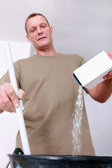 Worker mixing plaster