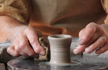 Creating a Small Clay Pot on a Potters Wheel.