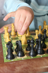 Close-up of little boy playing chess
