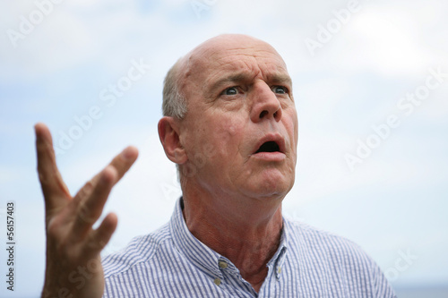 bald senior open-mouthed in surprise