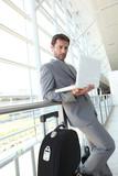 Businessman waiting at airport.