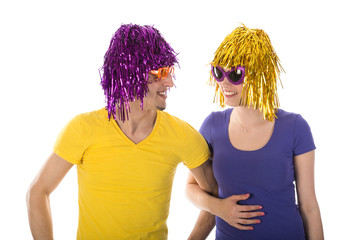 Happy man and woman with wigs and sunglasses