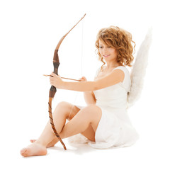 happy teenage angel girl with bow and arrow