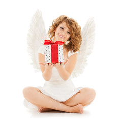 happy teenage angel girl with christmas gift