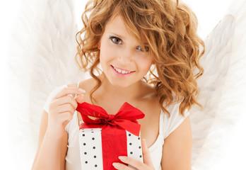 happy teenage angel girl with christmas gift