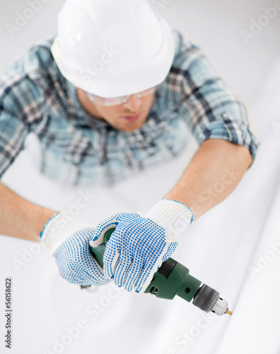 man drilling the wall