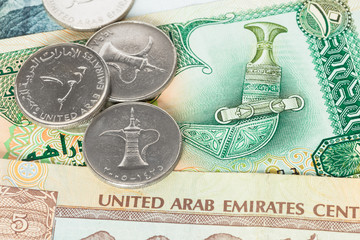 United Arub Emirates banknote and coins close-up