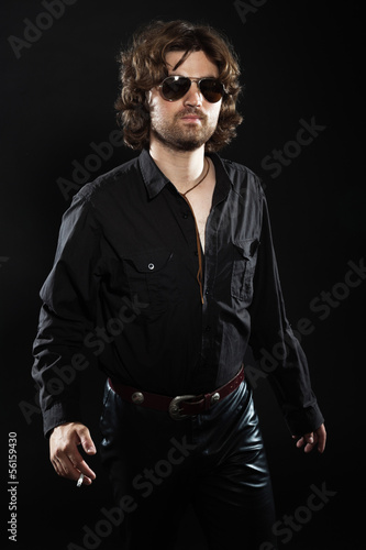 Cool rock style dancing musician with long brown hair and beard.