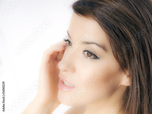 Dreamy style portrait of beautiful young woman