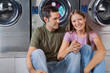 Woman Holding Man's Hand At Laundromat