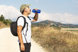Hiker driking water from bottle.